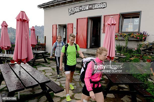 Norwegian athletes leave on July 23 2015 the Refuge du Plan de l'Aiguille in ChamonixMontBlanc after spending the night there before roller skiing in...