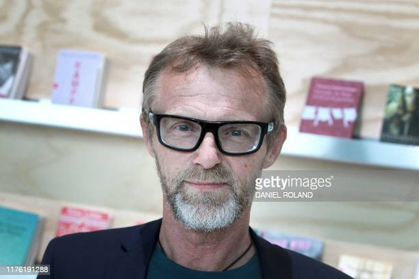 Norwegian author Jo Nesbo is pictured at the booth of this year's guest of honor Norway on the opening day of the Frankfurt book fair 2019 in...
