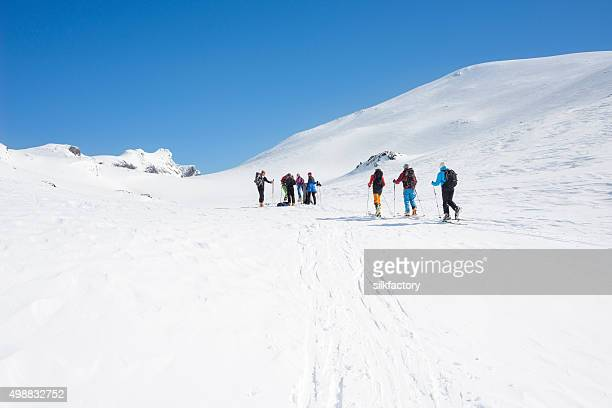 Norwegian backcountry skiers are ascending Mount Galdeberget in Jotunheimen