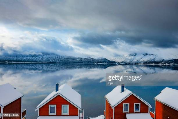 norwegian cabins on the fjord shore in northern norway in winter - traditionally norwegian stock pictures, royalty-free photos & images