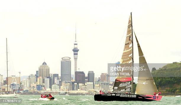 Norwegian challenge djuice skippered by Norway's Knut Frostad rounds North Head as they head out to the start line leaving Auckland behind them...