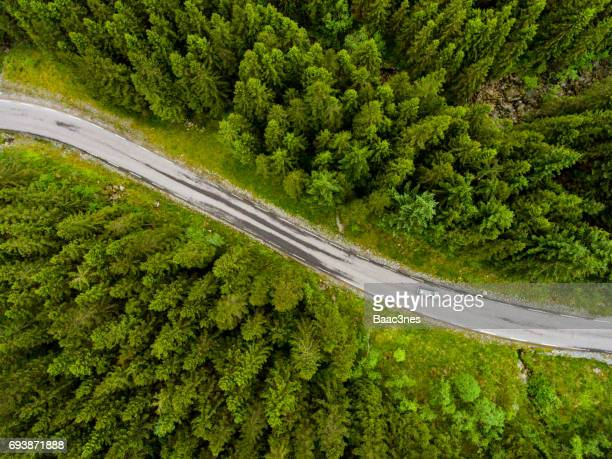 norwegian country road seen from above - aerial view bildbanksfoton och bilder
