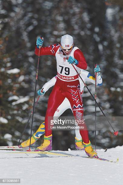 Norwegian cross country skier Bjorn Daehlie pictured in action to finish in first place to win the gold medal in the Men's 50 kilometres cross...