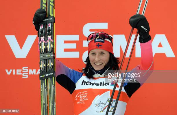 Norwegian cross country skier Marit Bjoergen celebrates during the winner ceremony after the 10 kilometers pursuit classic style women's competition...