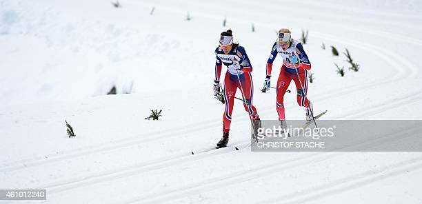 Norwegian cross country skier's Heidi Weng and her teammate Therese Johaug compete during the 10 kilometers pursuit classic style women's competition...
