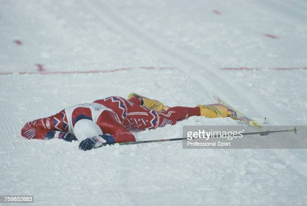Norwegian crosscountry skier Bjorn Daehlie pictured collapsed on the ground after crossing the line to finish in second place to win the silver medal...