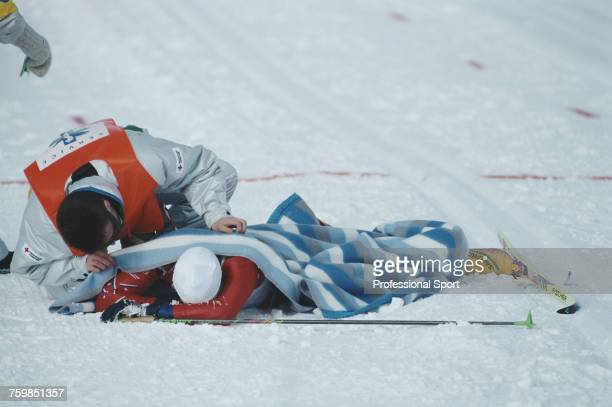 Norwegian crosscountry skier Bjorn Daehlie pictured receiving attention from a medic after collapsing on the ground after crossing the line to finish...