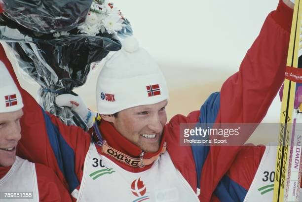 Norwegian crosscountry skier Vegard Ulvang pictured raising his arms in the air in celebration on the medal podium after finishing in first place to...
