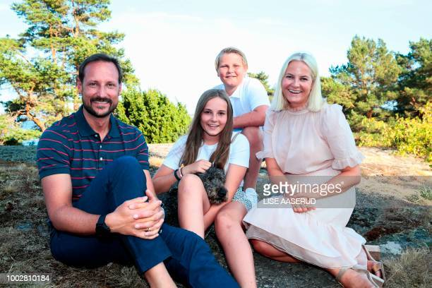 Norwegian Crown Prince Haakon celebrates his 45th birthday with his family while he poses beside Princess Ingrid Alexandra Prince Sverre Magnus and...