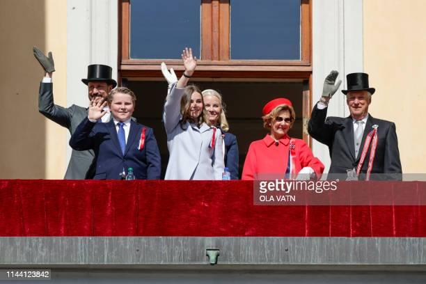 Norwegian Crown Prince Haakon Prince Sverre Magnus Princess Ingrid Alexandra Crown Prince Mette Marit Queen Sonja and King Harald wave from the...