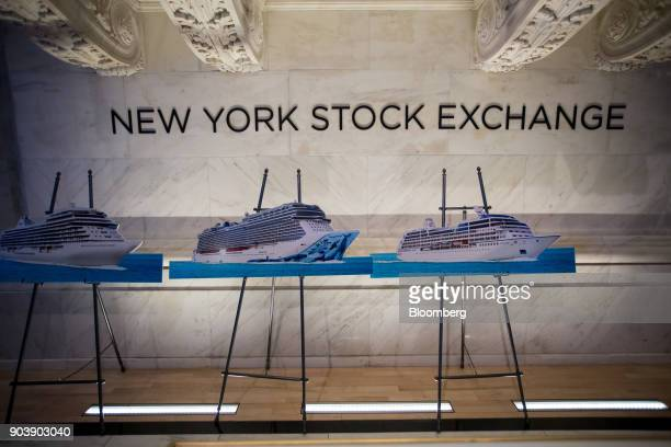 Norwegian Cruise Line Holdings Ltd cruise ship displays stand on the floor of the New York Stock Exchange in New York US on Thursday Jan 11 2018 US...