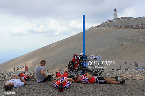 Norwegian cycling fans rest after riding up the mountain as they await the cyclists during stage fifteen of the 2013 Tour de France a 2425KM road...