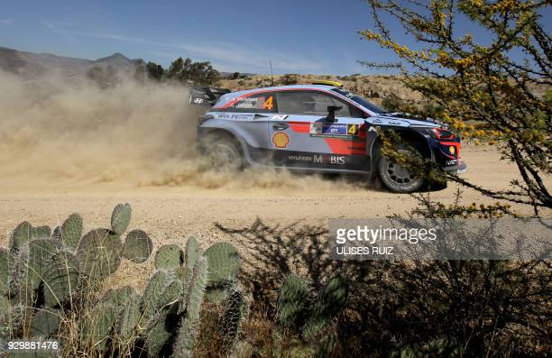 Norwegian driver Andreas Mikkelsen steers his Hyundai I20 Coupe WRC with compatriot codriver Anders JaegerSynnevaag during the first day of the 2018...