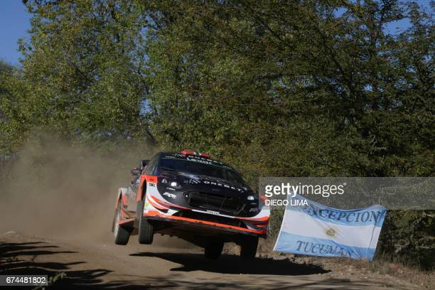 Norwegian driver Mads Ostberg steers his Ford Fiesta WRC with compatriot codriver Ola Floene during the SS3 between Amboy and Santa Monica near Santa...