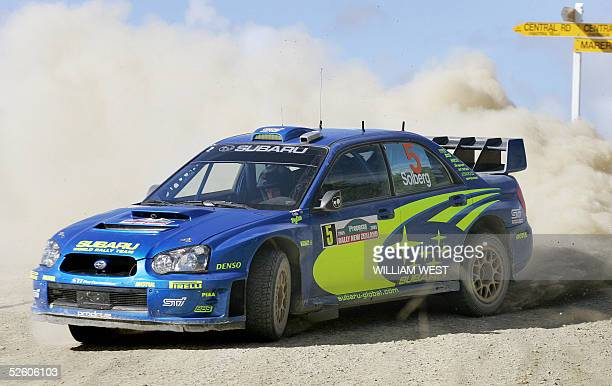 Norwegian driver Peter Solberg powers his Subaru through a corner during the second day of the Rally of New Zealand at Paparoa north of Auckland 09...
