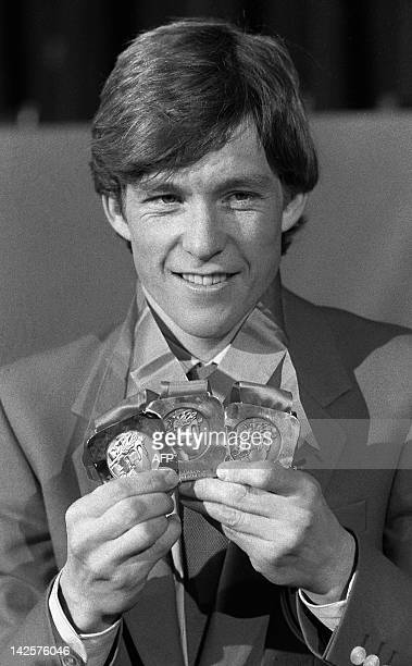 Norwegian Eirik Kvalfoss smiles during a press conference 18 February 1984 in Sarajevo as he displays his three medals won in the biathlon during the...