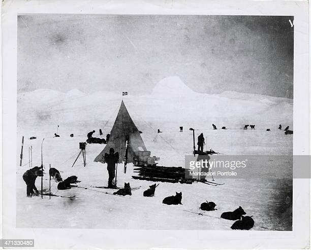 Norwegian explorer Roald Amundsen stopping with his crew during his expedition in the polar regions Antarctica 1911