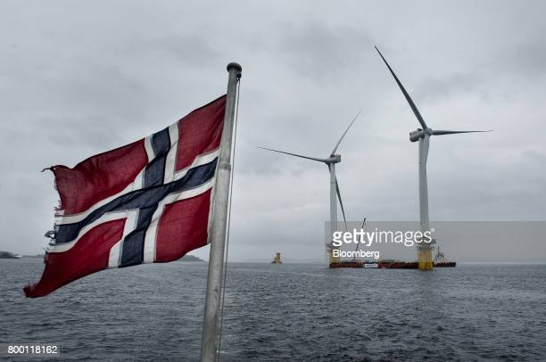 Norwegian flag flies from a boat near the assembly site of offshore floating wind turbines in the Hywind pilot park, operated by Statoil ASA, in...