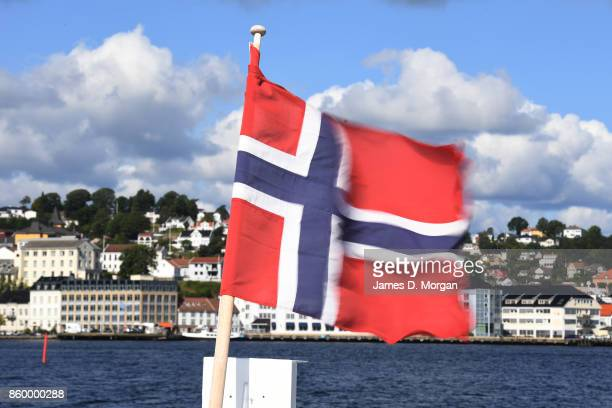 Norwegian flag in the Sogne harbour southern norway in Norway in August 22nd 2017