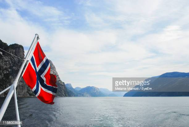 norwegian flag on ship at sea against sky - norwegian flag stock pictures, royalty-free photos & images