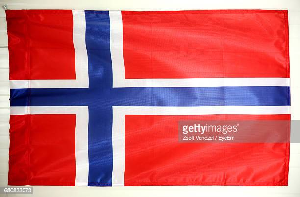 norwegian flag on white wall - norwegian flag stock pictures, royalty-free photos & images