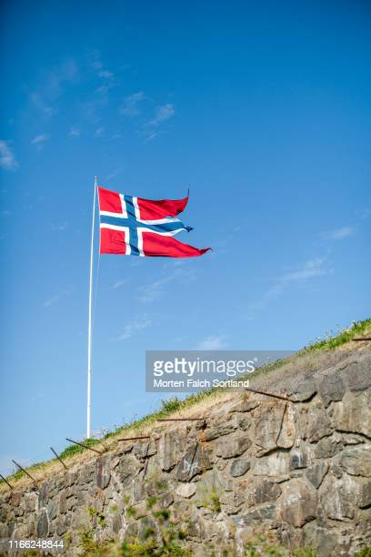 norwegian flag standing tall in trondheim, norway - flagpole stock pictures, royalty-free photos & images