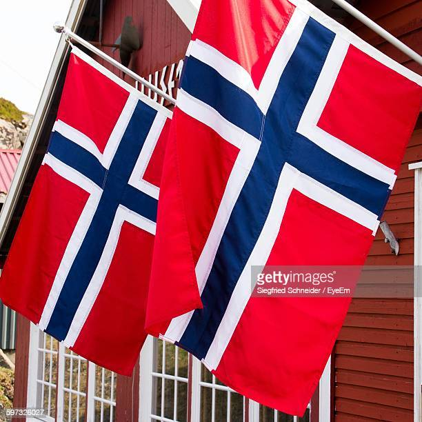norwegian flags on house - norwegian flag stock pictures, royalty-free photos & images