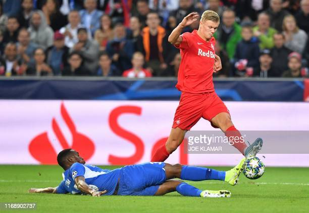 Norwegian forward Erling Braut Haland and RC Genk's Colombian defender Jhon Lucumi vie for the ball during the UEFA Champions League Group E football...