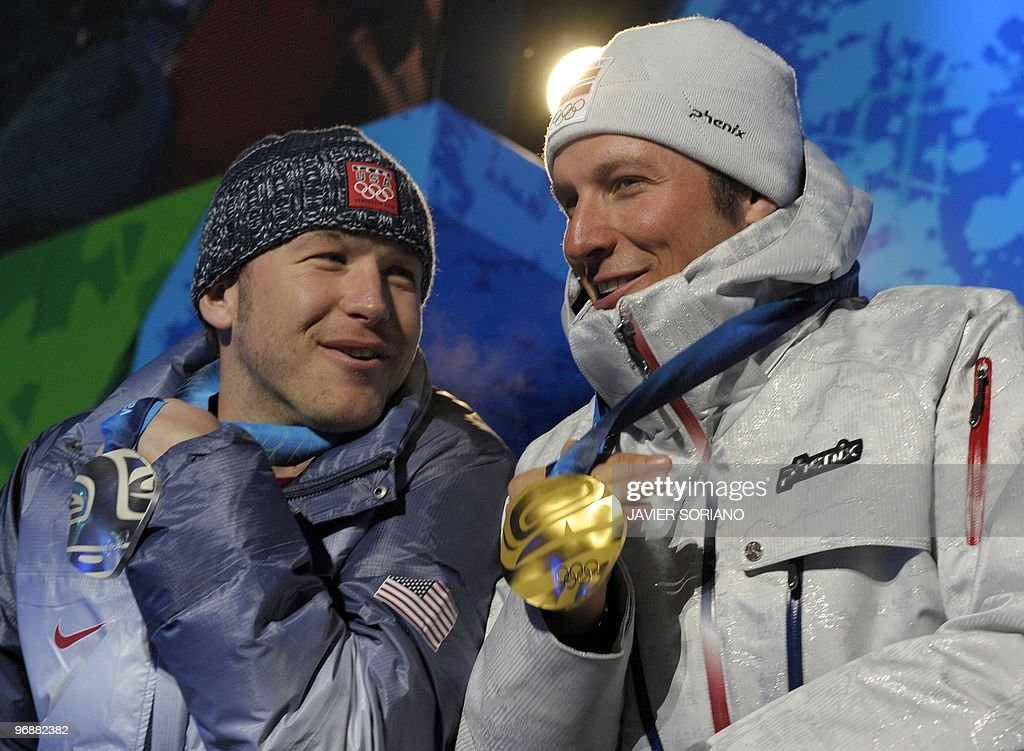 Norwegian gold medallist Aksel Lund Svindal (R) and US silver medallist Bode Miller pose for photographers during the medal ceremony for the Alpine skiing Men's Super-G event of the Vancouver 2010 Winter Olympics at Whistler Medal Plaza venue on February 19, 2010 in Whistler.