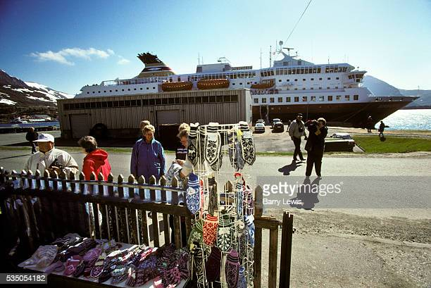 Norwegian handmade tourist goods on display as the ferry docks at Harstad For more than a century the coastal steamer Hurtigruten has been the...