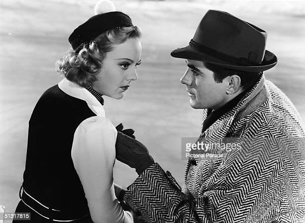 Norwegian ice skater/actress Sonja Henie and American actor Tyrone Power pose in a publicity still for the film 'Second Fiddle,' featuring songs by...