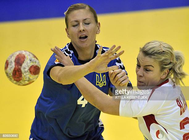 Norwegian Isabel Blanco fights for the ball with Ukrainian Anastasiia Pidpalova during the 8th Women's Handball European Championships match on...