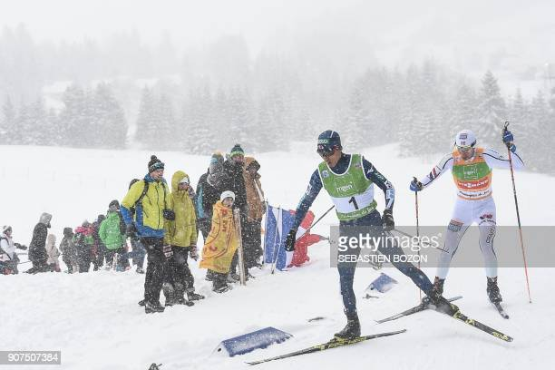Norwegian Jan Schmid and Japanese Akito Watabe compete during the individual Gundersen of the FIS Nordic Combined World Cup on January 20 2018 in...