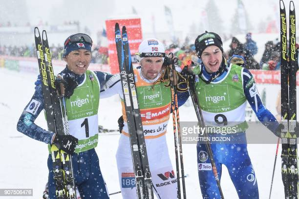 Norwegian Jan Schmid poses for photographers with Japanese Akito Watabe and Finnish Ikka Herola at the end of the individual Gundersen of the FIS...