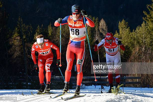 Norwegian Johnsrud Martin Sundby , Polish Maciej Kreczmer and Italian David Hofer compete in the men's 10 km Individual classic style competition of...