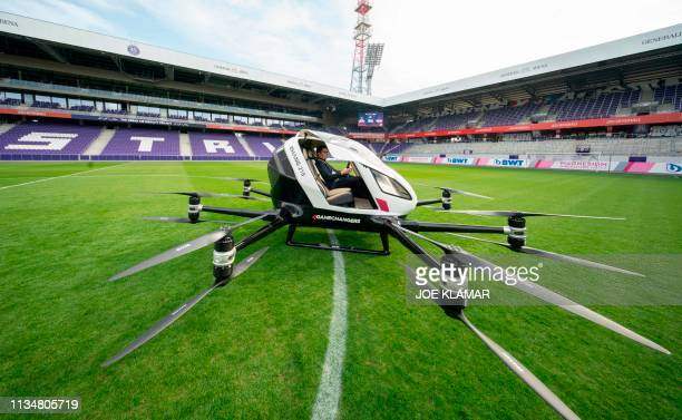 Norwegian journalist waits for a short flight in an Air Taxi EHANG 216 during a press preview of FACC AG on Urban Air Mobility at Generali Arena in...
