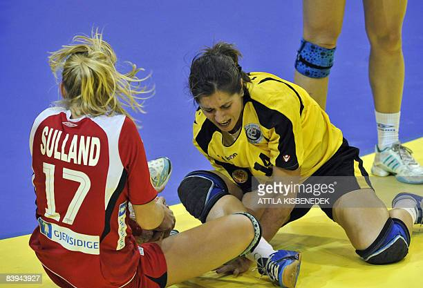 Norwegian Linn Sulland fights for the ball with Portuguese Renate Tavares during the 8th Women's Handball European Championships match on December 7...