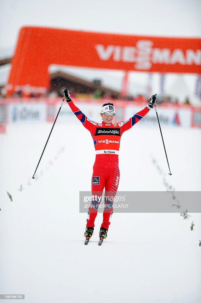Norwegian Marit Bjoergen crosses the finish line of the women's World Cup nordic skiing cross country 4 x 5 km Classic Free Relay , on January 20, 2013 in La Clusaz, south of France. Norway took the first place of the race. AFP PHOTO / Jean Pierre Clatot