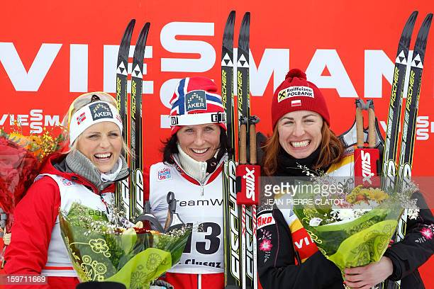 Norwegian Marit Bjoergen Norwegian Therese Johaug and Pole Lustyna Kowalczyk celebrate on the podium after the women's World Cup nordic skiing cross...