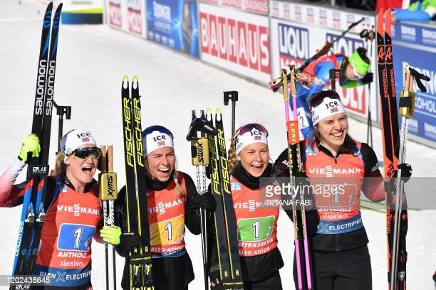 Norwegian Marte Olsbu Roiseland Norwegian Tiril Eckhoff Norwegian Ingrid Landmark Tandrevold and Norwegian Synnove Solemdal celebrate after winning...