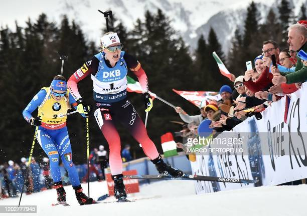 TOPSHOT Norwegian Marte Olsbu Roiseland overtakes Italian Dorothea Wierer on her way to win the Women 125 km Mass Start Competition at the IBU...