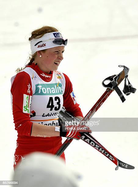Norwegian Marthe Kristoffersen stands in the finish area of the women's 10km freestyle FIS nordic ski World Cup in Lahti on March 8 2009 Pole Justyna...