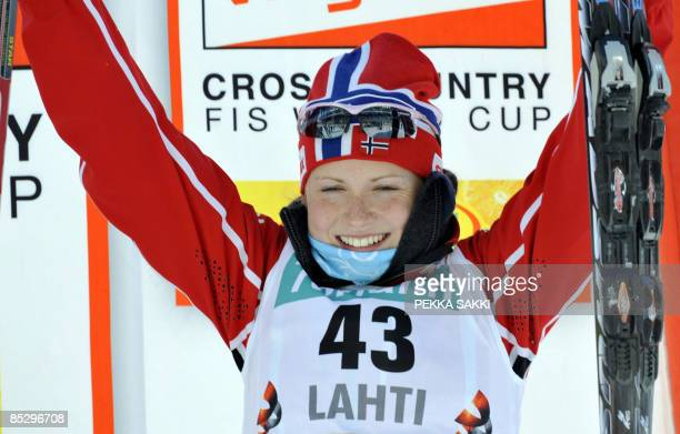 Norwegian Marthe Kristoffersencelebrates her third place in the women's 10km freestyle FIS nordic ski World Cup in Lahti on March 8 2009 Pole Justyna...