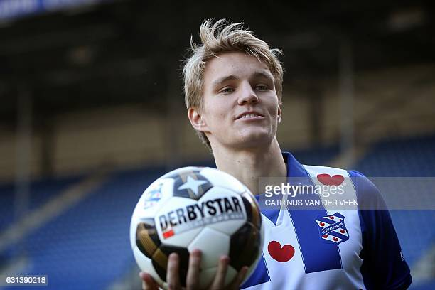 Norwegian Martin Odegaard holds a ball during his press presentation as SC Heerenveen's new player on January 10 2017 in Heerenveen The Frisian club...