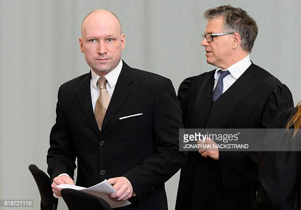 Norwegian mass killer Anders Behring Breivik and his lawyer Oystein Storrvik leave a makeshift court in Skien prisons gym on March 15 2016 in Skien...