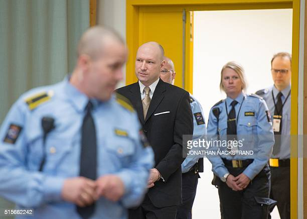 Norwegian mass killer Anders Behring Breivik enters a makeshift court in Skien prisons gym on March 15 2016 in Skien some 130 km south west of Oslo...