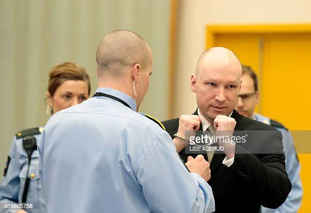 Norwegian mass killer Anders Behring Breivik has his handcuffs removed inside the court room in Skien prison March 16 2016 Behring Breivik is...