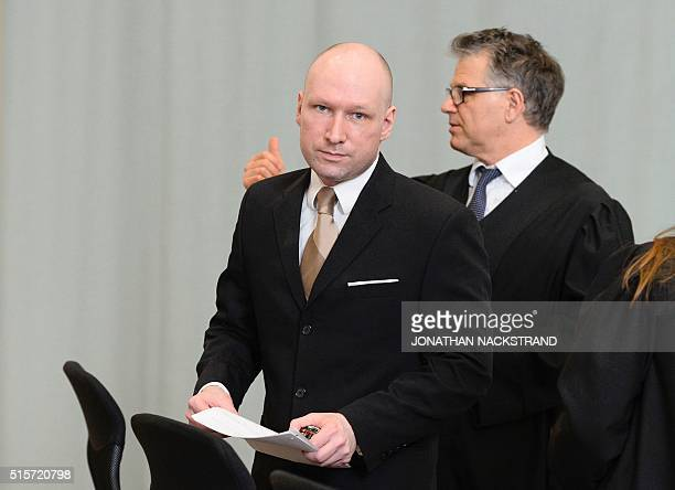 Norwegian mass killer Anders Behring Breivik is pictured as he leaves a makeshift court in Skien prisons gym on March 15 2016 in Skien some 130 km...