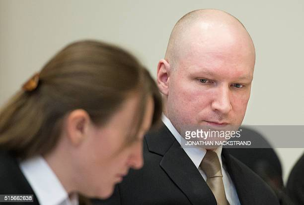 Norwegian mass killer Anders Behring Breivik is pictured at a makeshift court in Skien prisons gym on March 15 2016 in Skien some 130 km south west...