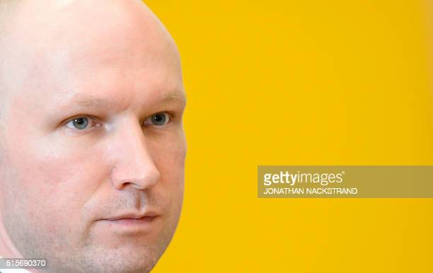 Norwegian mass killer Anders Behring Breivik is pictured at a makeshift court in Skien prisons gym after a lunch break on March 15 2016 in Skien some...